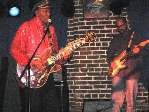 Rock legend Chuck Berry (l) and his son, Charles Berry Jr., a member of his band, play Feb. 13, 2008, at Blueberry Hill in St. Louis.
