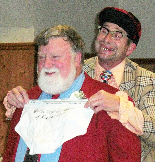 Having fun with -- actually being made fun of by -- Uncle Brooster at the 2009 Mississippi Valley Fair Christmas Party. (Photo courtesy of Bill Tubbs, North Scott Press)