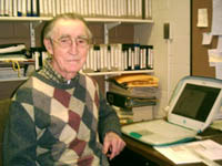 Grant Price at his desk at the Iowa Broadcasting Archives. Photo courtesy of ibna.org.
