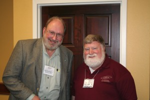 Jim Bohannon, left, a nationally syndicated radio talk show host and a panelist and the keynote speaker at the 2009 Iowa Broadcast News Association convention in Ames, chats with Phil.