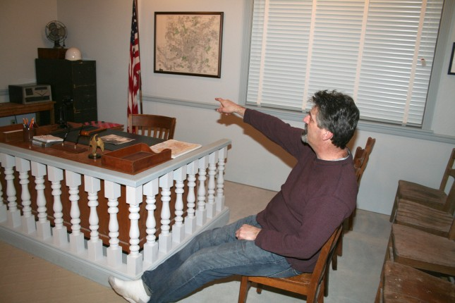 Dave points to some of the artifacts in the Mayberry Courthouse.