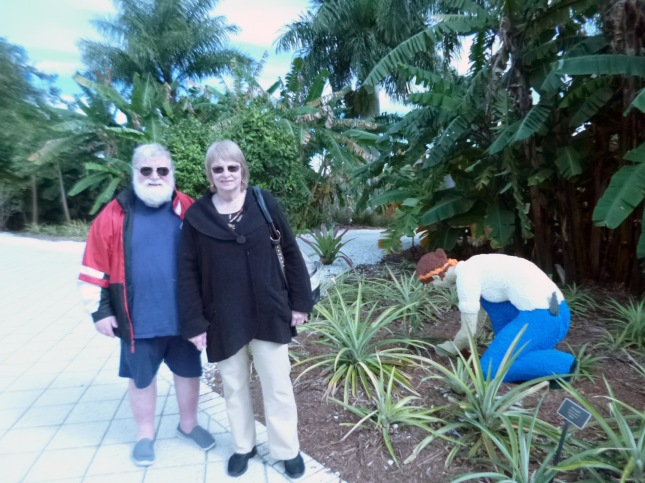 Phil and Sherry at Naples Botanical Garden next to a gardener made entirely of Legos.